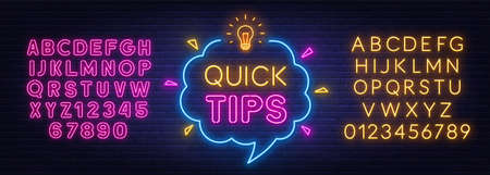 Quick Tips neon sign on brick wall background.