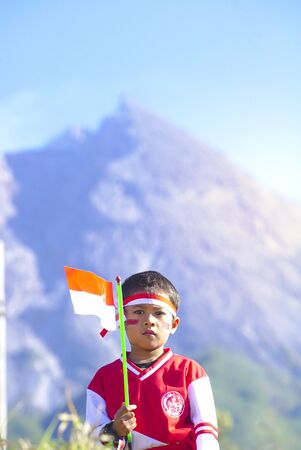 Young People with Flag. Indonesia Flag, Indonesia Independance Day with mt Merapi background