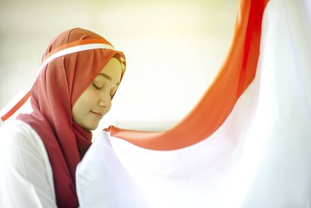 Asian Girl Kissing Indonesian flag, Indonesia independence day