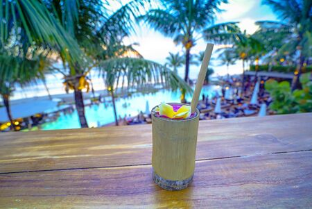 Fresh smoothies from a drink with view of island beach sunset and swimming pool bar from the tourist popular Potato Head Beach Club