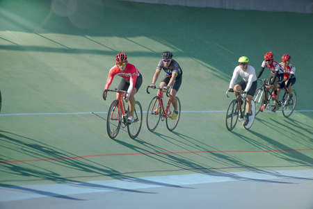 Surakarta Indonesia, June 20, 2020 : Action tracking paracycling shot of training cyclists racing on track in velodrome