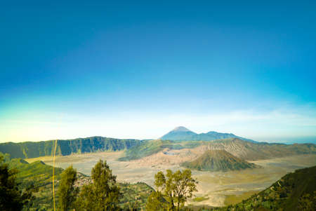 Mount Bromo is an active volcano, Indonesia. Panorama Bromo with blue sky background