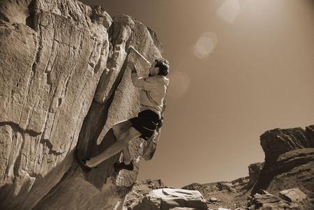 Man Rock Climbing Moab, Utah, USA