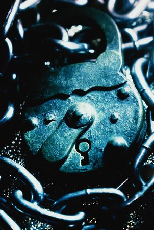Close-Up of Padlock and Chain LANG_EVOIMAGES