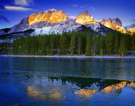 canmore: Sunrise over Mountains, Trees And Lake in Winter, Near Canmore, Alberta, Canada