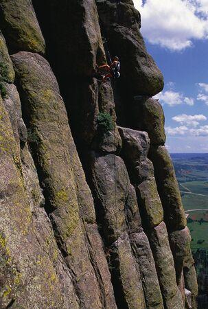 Man Rock Climbing, Devils Tower, Wyoming, USA LANG_EVOIMAGES