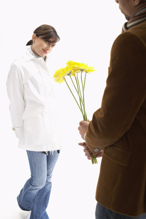 Man Giving Woman Flowers LANG_EVOIMAGES