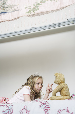 glower: Girl Playing With Teddy Bear
