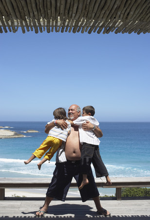 grampa: Grandfather Playing With Grandsons at the Beach