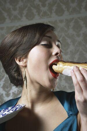Woman Eating Eclair