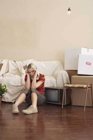 moving box: Woman Sitting in New Home LANG_EVOIMAGES