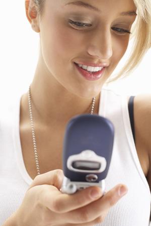 Girl Using Cellular Phone LANG_EVOIMAGES