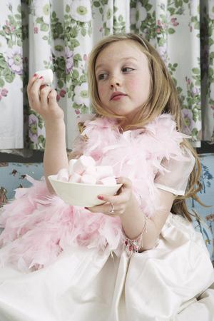 Girl Playing Dress Up, Eating Marhmallows