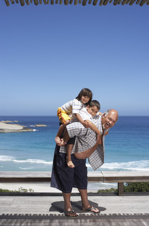 Portrait of Grandfather and Grandsons at the Beach