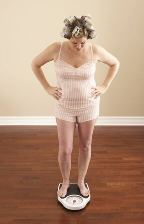 women's issues: Woman Weighing Self