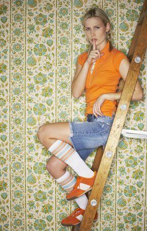 shushing: Portrait of Woman on Ladder