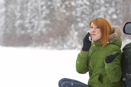 Woman Using Cellular Telephone Outdoors LANG_EVOIMAGES