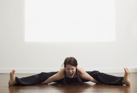 athletic wear: Woman Stretching LANG_EVOIMAGES