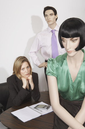Buisnesswoman and Mannequins in Office