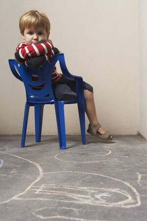 disobedience: Boy Sitting in Chair