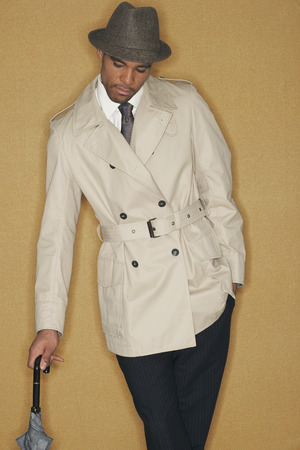 jamaican adult: Man in Trench Coat and Hat
