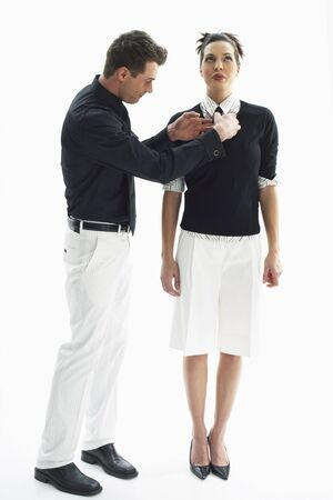 Businessman Adjusting Businesswomans Tie