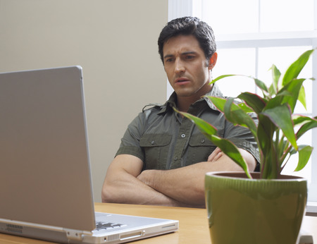 perturbed: Man Working on Laptop