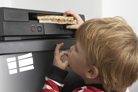 Boy Putting Sandwich in VCR LANG_EVOIMAGES