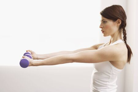 athletic wear: Woman Lifting Weights