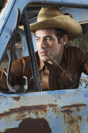 down beat: Portrait of Man in Pickup Truck LANG_EVOIMAGES