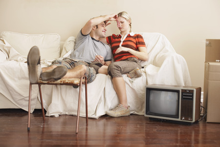 30 years old man: Couple Sitting on Couch
