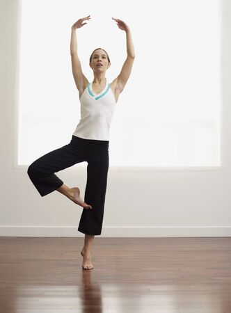 athletic wear: Woman Practicing Ballet LANG_EVOIMAGES