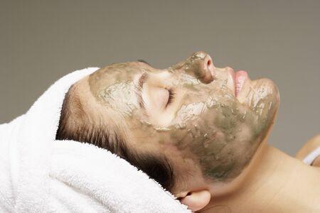 Woman Wearing Mud Mask LANG_EVOIMAGES
