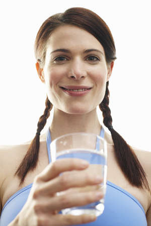 Woman Holding Glass of Water LANG_EVOIMAGES