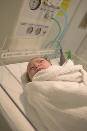 swaddling: Newborn Baby in Delivery Room