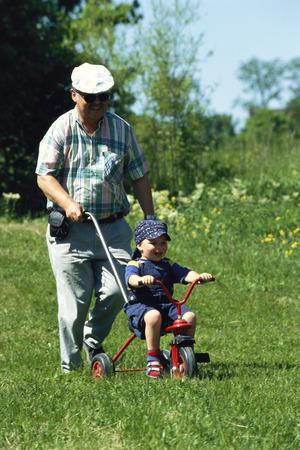 grampa: Child Being Pushed on Bicycle