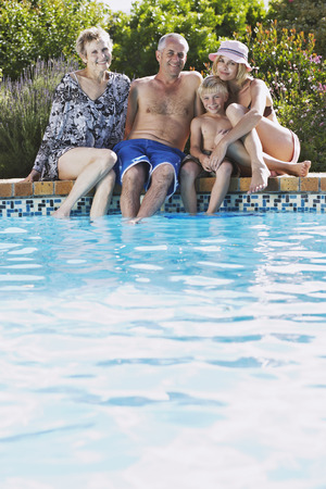 Family by Pool LANG_EVOIMAGES