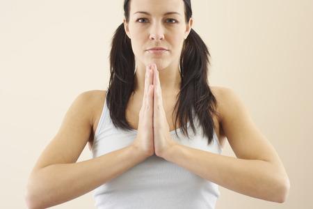 Woman Praying LANG_EVOIMAGES