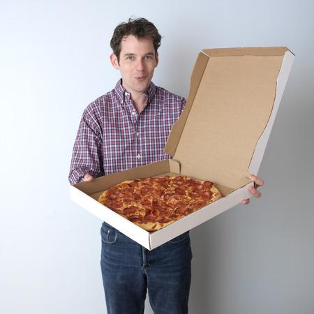 Portrait of Man Holding Pizza