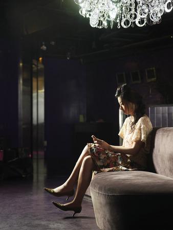 Woman Sitting in Club