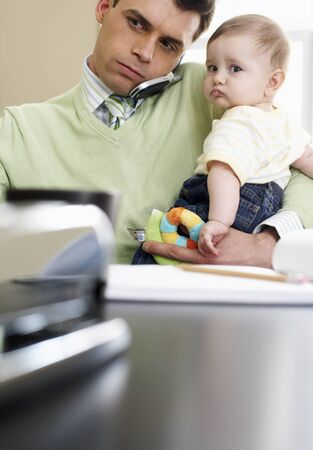 work related: Father with Baby LANG_EVOIMAGES