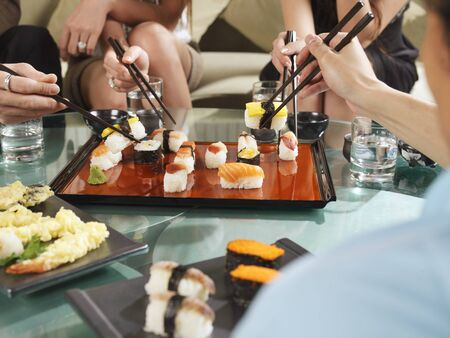 People Eating Sushi LANG_EVOIMAGES