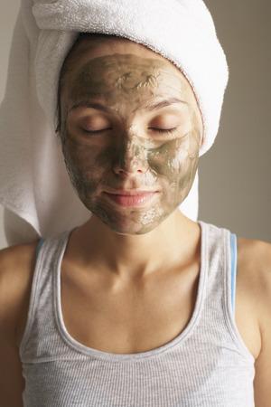 rejuvenated: Woman Wearing Mud Mask LANG_EVOIMAGES