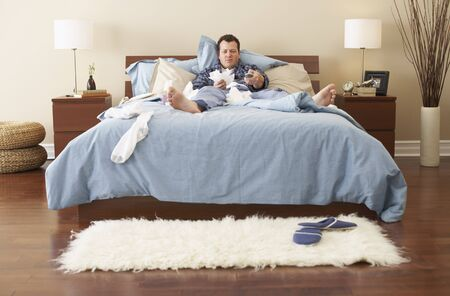 communicable: Man Sick in Bed