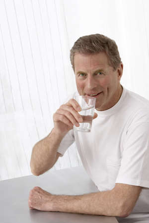 Portrait of Man With Glass of Water
