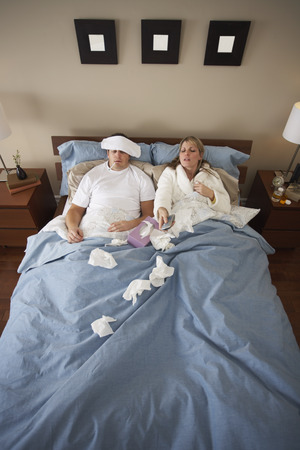 communicable: Sick Couple in Bed