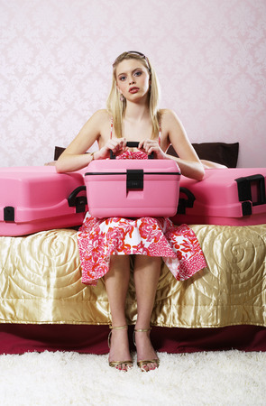 Portrait of Woman in Bedroom, With Suitcases LANG_EVOIMAGES