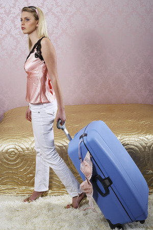 Woman With Suitcase, Bra Falling Out of Suitcase LANG_EVOIMAGES