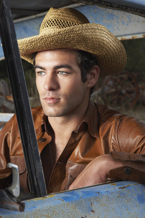 down beat: Man In Cowboy Hat and Rusty Truck
