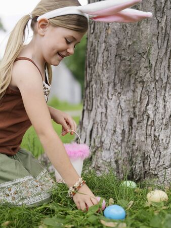 Girl Collecting Easter Eggs